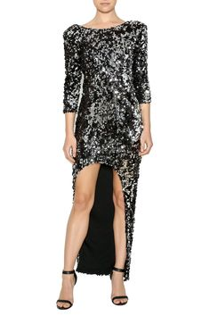 High-low, black sequin dress features scoop neckline, plunging back detail, and shoulder pads.   Sequin Hi-Low Dress Clothing - Dresses - Formal Clothing - Dresses - Maxi Las Vegas