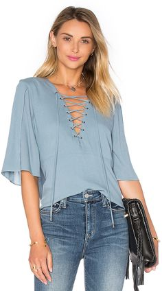 Shop for Lovers + Friends Boulevard Top in Dusty Blue at REVOLVE. Lace Up T Shirt, Modelos Plus Size, Plain Dress, Pastel Fashion, Short Tops, Blouse Styles, Blouses For Women, Fashion Beauty, Boho Fashion
