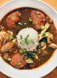 Cajun Gumbo Recipe for Smoked Andouille Sausage _ Chicken stock is basis for this recipe that includes smoked Andouille sausage, onions, celery, & green pepper. You can add okra to the gumbo; anything goes for this dish! Garnish: Parsley & green onion; filé powder.