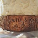 cake base made of tree trunk with names and date carved