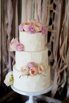 Spring wedding cake idea - three-tier, buttercream-frosted wedding cake with roses, peonies + ranunculuses {Marlon Taylor Photography}