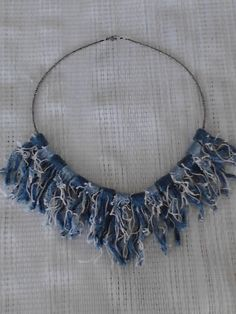 Hey, I found this really awesome Etsy listing at http://www.etsy.com/listing/108582470/denim-blue-jean-rag-quilt-bead-necklace