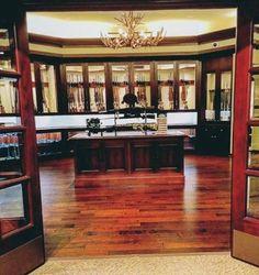 huge-collectors-gun-room-inspiration-with-antler-chandelier-decor
