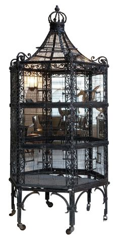 Wrought iron birdcage  Not sure how practical it would be but can you imagine how beautiful it would look filled with candles?!?!?!?