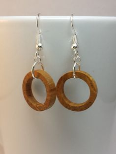 These hawthorne tiny hoop earrings are completely handmade. The lines and coloring are the natural wood grain. These earrings are sealed with