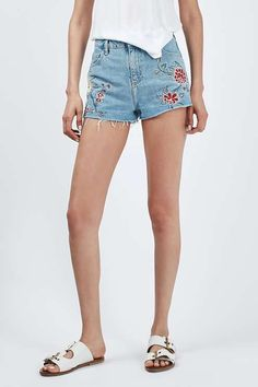 Take the denim short up a notch with this whimsy embroidered style. Cut in a signature high-waist with multiple pockets and a raw cut-off hem with splits at the side seam. We love the super-cute floral embroidery details. #Topshop