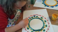 Mandala art idea. Paint is dabbed through a paper doilie then a pattern is revealed when the doilie is removed.