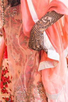 Bridal Details - Peach Floral Lehenga with Peach Georgette Dupatta and Henna on Hands | WedMeGood #wedmegood #lehenga #indianbride #indianwedding #mehendi #floral