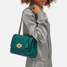 Shop the Medium Lily in Ocean Green Leather at Mulberry.com. The Medium Lily is the larger version of the effortlessly elegant Lily bag. It has the same woven leather and chain strap, which can be worn short or long, and is finished with signature details such as the postman's lock and leather padlock fob.