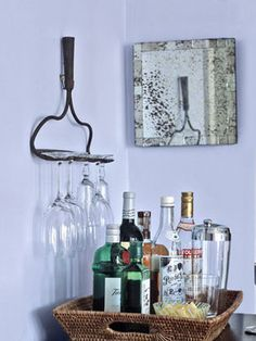 What a great creative idea for your wine glasses and you get to repurpose an old head to a broken rake.