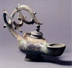 Byzantine Bronze Oil Lamp with Cross Handle  PERIOD  Sixth Century AD