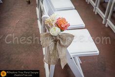 !schwartz-19-bear-mountain-inn-wedding-flowers-ceremony-chair-flower--roses-stock-orange-white-burlap-bow