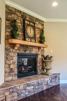 Fabulous Fireplaces | Liking the stone and wood block mantle. See more: http://homechanneltv.blogspot.com/2015/01/fabulous-fireplaces.html
