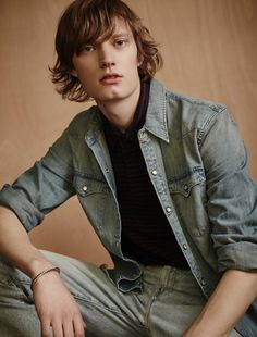 Thom wears vintage bracelet stylist's own, shirt, polo and jeans Levi's Made & Crafted.