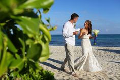 Beach wedding Riviera Maya Now Jade Resort, newlyweds celebrating love in the Mexican Caribbean.  Mexico wedding photographers Del Sol Photography