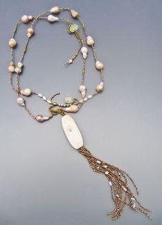 Antique African shell, antique French brass seed beads, fresh water pearls LuciaAntonelli.com