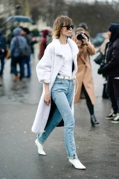 Anya Ziourova wears a white coat a white tshirt blue denim jeans white shoes outside Chanel during Paris Fashion Week Haute Couture Spring/Summer...