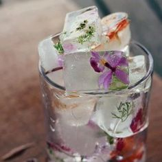 How pretty!! Freeze edible flowers and herbs in ice cubes. Boiling the water first helps to create a clear ice cube.  Violas, lavender and organically grown roses are all good choices... as well as borage flowers and sage blossoms