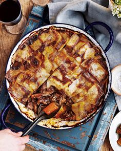 Swap the traditional roast for this slow-cooked hotpot. In this recipe lamb shanks are cooked until tender in red wine and then topped with crispy slices of potato – a guaranteed crowdpleaser. Lamb Recipes, Slow Cooker Recipes, Cooking Recipes, Slow Cooking, Meat Recipes, Savoury Recipes, Slow Cooked Lamb Shanks, Lamb Shank Recipe, Sliced Potatoes