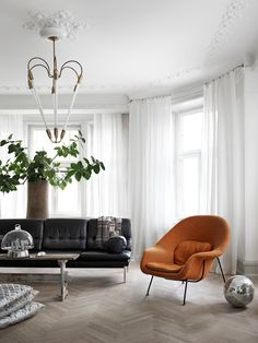 my scandinavian home: Womb chair and leather sofa in a striking Malmo pad with attitude!