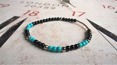 Mens Protection Minimalist Spiritual Bracelet, Onyx Hematite Turquoise Bracelet, Surfer Bracelets Yoga Man Gemstone Mala Beads Bracelet  This is a handmade healing, chakra energy balancing bracelet, made of natural Turquoise black Onyx, Lapis Lazuli, and red Coral beads. This is an elegant piece of bohemian jewelry - an excellent gift for husband or boyfriend. CHARACTERISTICS: **********************  4mm Turquoise, black Onyx, and Hematite  Silver color charm  Stretch cord bracelet  S...