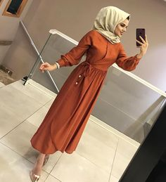 Image may contain: 1 person, standing and shoes Modern Hijab Fashion, Abaya Fashion, Muslim Fashion, Fashion Dresses, Hijab Dress Party, Hijab Outfit, Dress Outfits, Simple Hijab, Hijab Chic