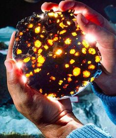 From a Violent Collision Comes Celestial Beauty – Amber inclusions of olivine in meteorite..