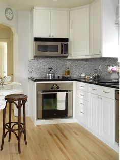 Suzie: Margot Austin - Gorgeous small L shaped kitchen with white kitchen cabinets with ...