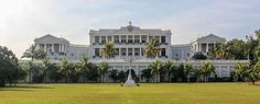 "Falaknuma Palace is one of the finest palaces in Hyderabad, Telangana, India. It belonged to Paigah Hyderabad State, and it was later owned by the Nizams.[1] It is on a 32-acre (13 ha) area in Falaknuma, 5 km from Charminar. It was built by Nawab Vikar-ul-Umra, prime minister of Hyderabad and the uncle and brother-in-law of the Nizam VI, Nawab Mir Mahboob Ali Khan Bahadur.[2] Falak-numa means ""Like the Sky"" or ""Mirror of the Sky"" in Urdu."