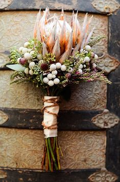 Textured Protea bouquet with silver-grey Berzelia and burgundy leucadendron buds Protea Wedding, Floral Wedding, Wedding Bouquets, Rustic Wedding, Wedding Flowers, Protea Bouquet, Floral Bouquets, Floral Wreath, Protea Flower
