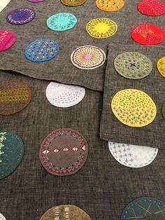 Lynn Krawczyk's embroidered wool felt circles, on Quilting Arts TV Series 1600. #QATV