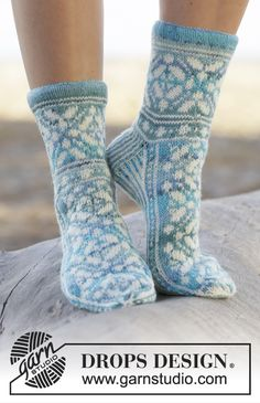 "Ice Magic - Knitted DROPS socks with Norwegian pattern in ""Fabel"". Size 35 - 43 - Free pattern by DROPS Design Lace Socks, Crochet Socks, Knitted Slippers, Wool Socks, Knit Mittens, Knit Crochet, Knit Lace, Fair Isle Knitting, Lace Knitting"