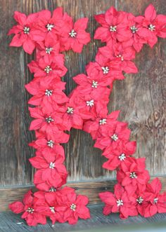 christmas! This would be so easy to hot glue cut flowers to a letter...or stick them in a foam letter...cute!