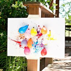 DIY Backyard Games   Fill balloons with paint and let kids throw plastic darts at them. It's a fun game for the kiddos that also makes a one-of-a-kind work of art!