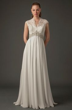 Danielle Caprese High Neck Mermaid Gown in Lace This mermaid gown features an high neck neckline with a dropped waist in lace. It has a chapel train and cap sleeves. This gown is Exclusive to Kleinfeld Bridal.