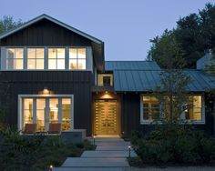 metal roofs are the best! and the best in fire areas... great windows with the dark gray board & batten siding