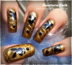 """How To Get """"Playboy Bunny"""" Nails:  1. Apply base coat as usual and magnetic polish.  2. Stick Playboy stencils and with a piece of sponge gently apply creme black nail polish.  3. Add black rhinestones and seal everything with clear top coat."""