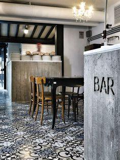 ornate under bar detailing contrasted against an asymmetrical tile