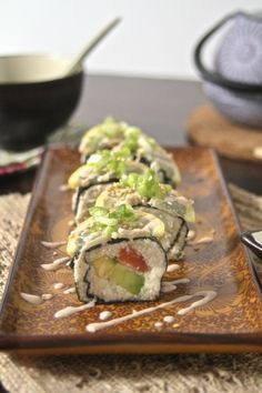 """100% Raw Sushi with Mango, Avocado, Cucumber, Cauliflower """"Rice"""" and even a Raw Spicy Mayo! Make with or without raw fish."""