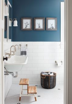 farmhouse bathroom idea with navy blue walls white subway tiles walls wall mounted sink small wood staircases black basket for storage white mosaic tiles floors of Great Choices of Fancy Colors for A Small Bathroom