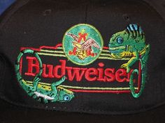 d3ef5f9bb1d Black embroidered Budweiser Lizards Frank and Louie Hat featuring Frank    Louie Hanging on the Budweiser Marquis