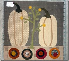 Could change out the color, smush down the pumpkins into balls, and make this a Christmas one!    Autumn Quilt Block