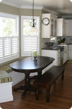 Love this kitchen (colors and all) We could do a similar small built in table against our window wall.