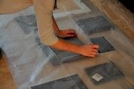 use wax paper to make picture frame layout. outline, then tape onto wall to get nails in the right place