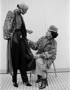 Eunice Johnson (seated), Ebony Fashion Fair producer and director, inspects a model in an ensemble by Valentino, 1978. Image courtesy of Johnson Publishing Company, LLC
