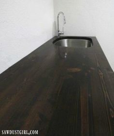 Today I'm showing you how to build a wood countertop with undermount sink like the one I built for my laundry room. At a total cost of about $25!
