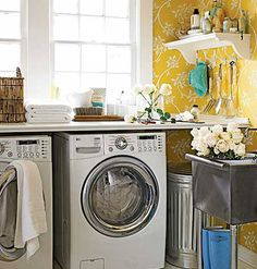 Pretty wallpaper and a handy utility sink turned this lackluster laundry room into a flowery workstation for everyday chores. myhomeideas.com