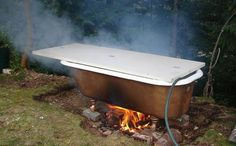 Forget a fancy hot tub. You can just find a cast iron tub (didn't know they even made those), and with a few tools and some lovin', you can have your own fire tub! Old Bathtub, Outdoor Bathtub, Outdoor Bathrooms, Outdoor Showers, Bath Tub, White Bathrooms, Luxury Bathrooms, Master Bathrooms, Dream Bathrooms