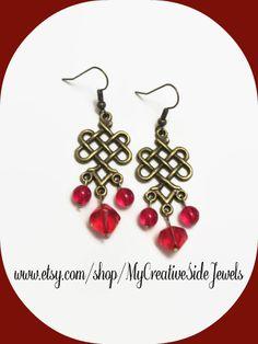 Red Celtic knot dangle earrings.  Handmade.  SHOP: https://www.etsy.com/shop/MyCreativeSideJewels