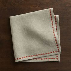 Orange embroidery traces a dotted trail on natural linen napkin.  Mix and match with Marianna Sprig napkins and coordinating placemats and runners. 100% linenMachine wash separately in cold water, dry flatDo not dry clean, iron or bleachMade in India.